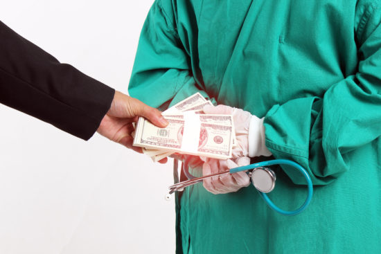 money-cash-doctor-stethescope-stark-fraud-bribe-shutterstock_613656494